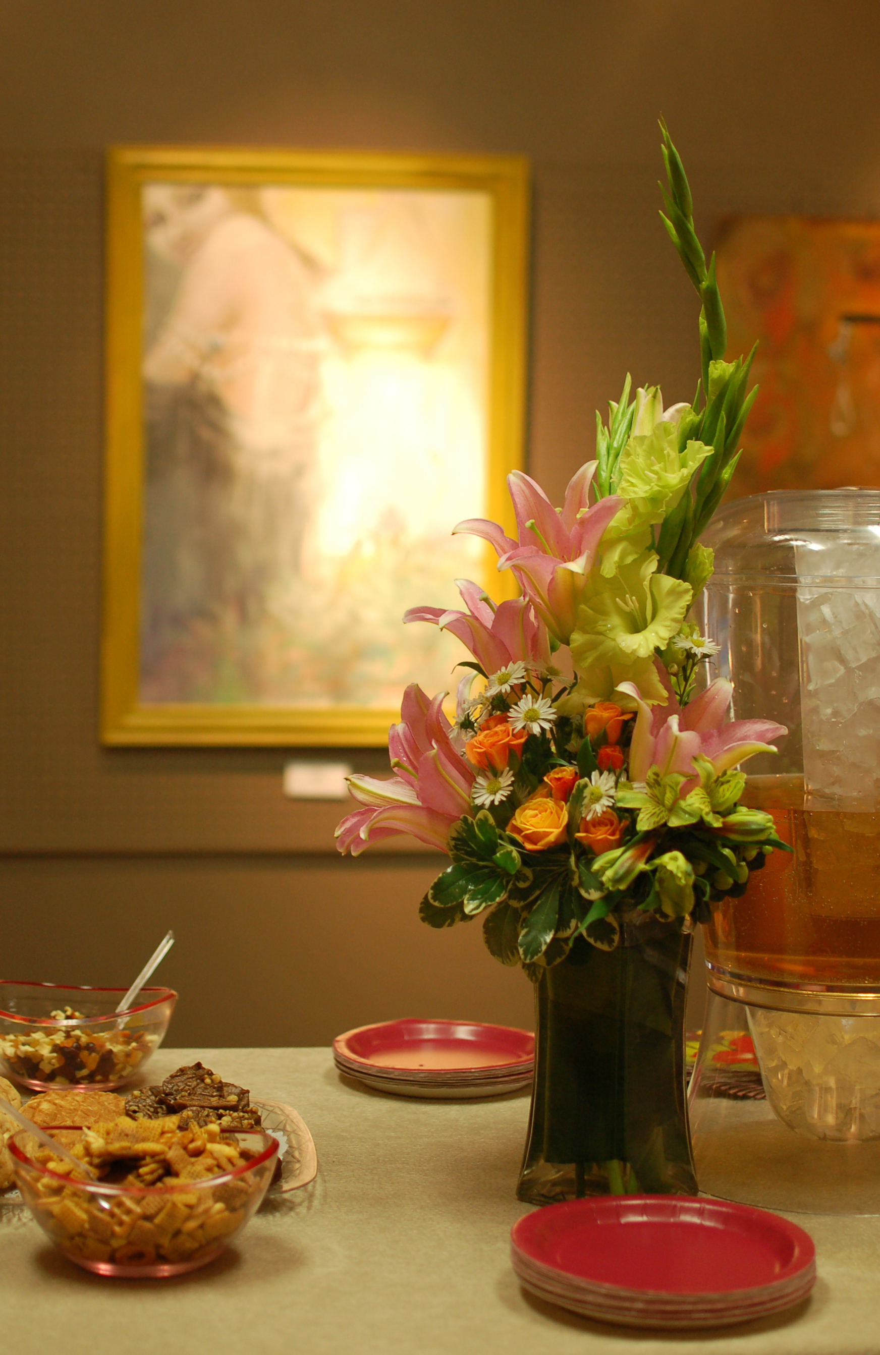 Flowers on my reception table in front of my painting Surface